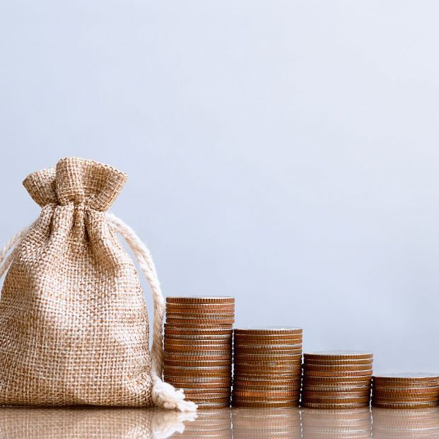 bigstock Coins In Sack And Coins Stack  393583472