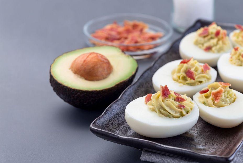bigstock Deviled Eggs Stuffed With Avoc 306673288